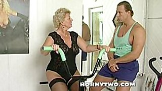 Horny granny wench shamelessly takes gym traine...