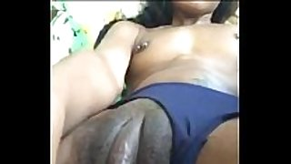 Ebony playgirl with large love button strokes her fur pie