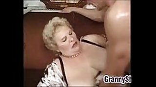 Fat and breasty granny enjoying a penis