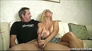 Huge-titted milf enjoys jerking dongs