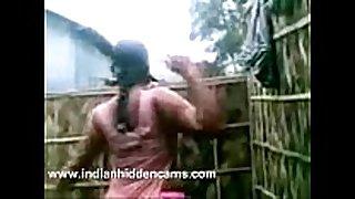 Indian dark rod strumpets from village taking open air shower...