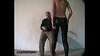 Girl in leather pants kick a man 01