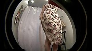 Hidden spycam web camera in shower dressing