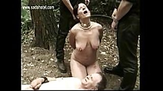 Hot and lewd thrall tied to tree with got playe...