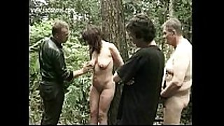 Milf slave bound to a tree gets spanked on her l...